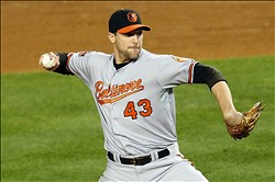 Oct 10, 2012; Bronx, NY, USA;  Baltimore Orioles relief pitcher Jim Johnson (43) pitches during the ninth inning of game three of the 2012 ALDS against the New York Yankees at Yankee Stadium.  Yankees won 3-2 in twelve innings.  Mandatory Credit: Anthony Gruppuso-US PRESSWIRE