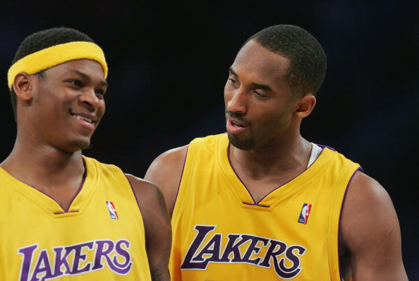 LOS ANGELES, CA - FEBRUARY 13:  Kobe Bryant #24 talks with his teammate Smush Parker #1 of the Los Angeles Lakers during the game against the New York Knicks on February 13, 2007 at Staples Center in Los Angeles, California. NOTE TO USER: User expressly acknowledges and agrees that, by downloading and/or using this Photograph, user is consenting to the terms and conditions of the Getty Images License Agreement. Mandatory Copyright Notice: Copyright 2007 NBAE.  (Photo by Lisa Blumenfeld/Getty Images)