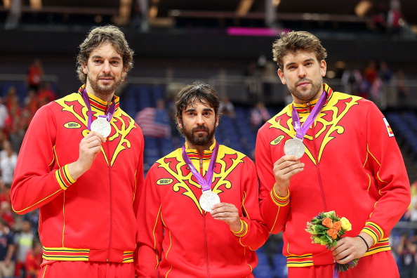 LONDON, ENGLAND - AUGUST 12:  Silver medallists Pau Gasol #4 of Spain and Marc Gasol #13 of Spain pose on the podium with team mate Victor Sada #15 of Spain during the medal ceremony for the Men's Basketball on Day 16 of the London 2012 Olympics Games at North Greenwich Arena on August 12, 2012 in London, England.  (Photo by Christian Petersen/Getty Images)