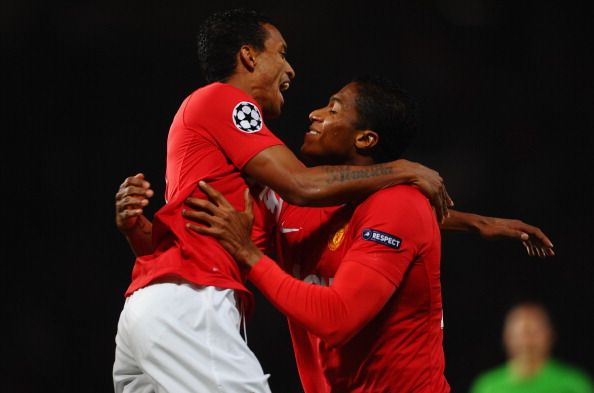 MANCHESTER, ENGLAND - NOVEMBER 02:  Antonio Valencia of Manchester United (R) celebrates with Luis Nani as he scores their first goal during the UEFA Champions League Group C match between Manchester United and Otelul Galati at Old Trafford on November 2, 2011 in Manchester, England.  (Photo by Laurence Griffiths/Getty Images)