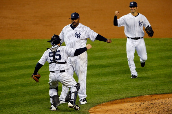 NEW YORK, NY - OCTOBER 12:  CC Sabathia #52, Russell Martin #55 and Eric Chavez #12 of the New York Yankees celebrate after defeating the Baltimore Orioles by a score of 3-1 to win Game Five of the American League Division Series at Yankee Stadium on October 12, 2012 in New York, New York.  (Photo by Alex Trautwig/Getty Images)