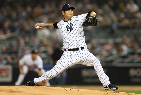 NEW YORK, NY - OCTOBER 03:  Hiroki Kuroda #18 of the New York Yankees delivers a pitch in the first inning against the Boston Red Sox on October 3, 2012 at Yankee Stadium in the Bronx borough of New York City.  (Photo by Elsa/Getty Images)