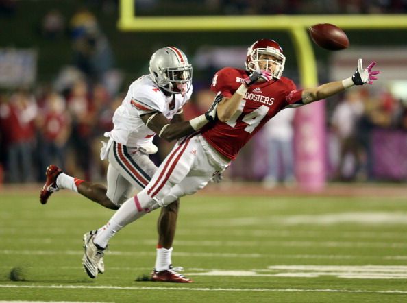 BLOOMINGTON, IN - OCTOBER 13:  Nick Stoner #14 of the Indiana Hoosiers reaches to catch the ball during the game against the Ohio State Buckeyes at Memorial Stadium on October 13, 2012 in Bloomington, Indiana.  (Photo by Andy Lyons/Getty Images)