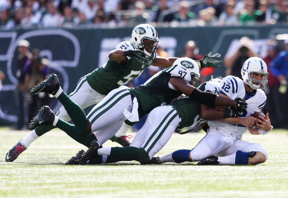 EAST RUTHERFORD, NJ - OCTOBER 14:  Andrew Luck #12 of the Indianapolis Colts is sacked by Aaron Maybin #51, Calvin Pace #97 and Antonio Allan #39 of the New York Jets at MetLife Stadium on October 14, 2012 in East Rutherford, New Jersey.  (Photo by Nick Laham/Getty Images)