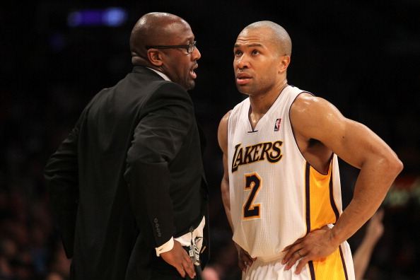 LOS ANGELES, CA - MARCH 11:  Head coach Mike Brown of the Los Angeles Lakers talks with Derek Fisher #2 during hte game against the Boston Celtics at Staples Center on March 11, 2012 in Los Angeles, California.  The Lakers won 97-94.  NOTE TO USER: User expressly acknowledges and agrees that, by downloading and or using this photograph, User is consenting to the terms and conditions of the Getty Images License Agreement.  (Photo by Stephen Dunn/Getty Images)