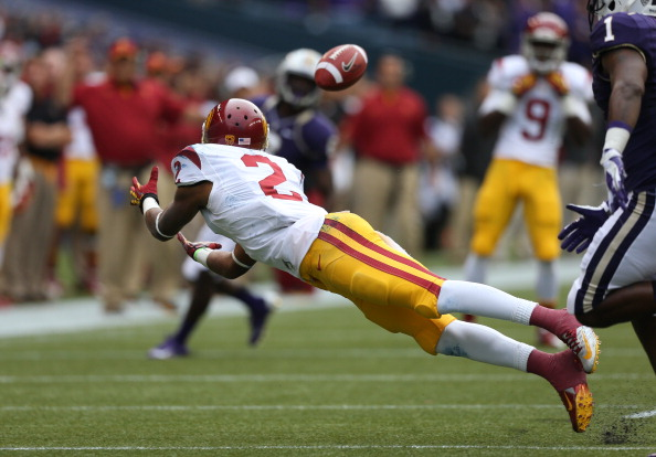 SEATTLE, WA - OCTOBER 13:  Wide receiver Robert Woods #2 of the USC Trojans makes a diving catch against the Washington Huskies on October 13, 2012 at CenturyLink Field in Seattle, Washington. The Trojans defeated the Huskies 24-14.  (Photo by Otto Greule Jr/Getty Images)