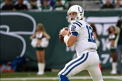 Oct 14, 2012; East Rutherford, NJ, USA; Indianapolis Colts quarterback Andrew Luck (12) looks to pass the ball against the New York Jets during the second half at MetLife Stadium. Jets won 35-9. Mandatory Credit: Debby Wong-US PRESSWIRE