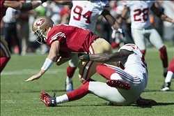 October 14, 2012; San Francisco, CA, USA; San Francisco 49ers quarterback Alex Smith (11) is sacked by New York Giants defensive end Jason Pierre-Paul (90) during the first quarter at Candlestick Park.  Mandatory Credit: Ed Szczepanski-US PRESSWIRE