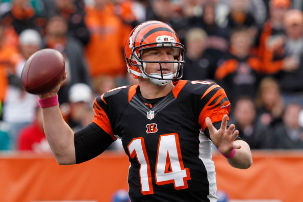 CINCINNATI, OH - OCTOBER 07:  Quarterback Andy Dalton, 14 of the Cincinnati Bengals, throws the ball against the Miami Dolphins at Paul Brown Stadium on October 7, 2012 in Cincinnati, Ohio. The Dolphins won, 17-13. (Photo by Tyler Barrick/Getty Images)