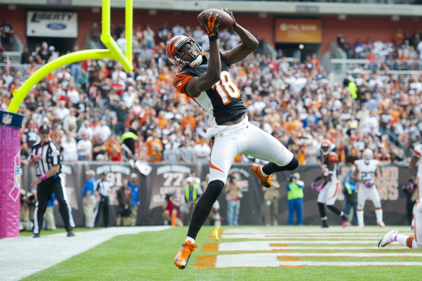 CLEVELAND, OH - OCTOBER 14: Wide receiver A.J. Green #18 of the Cincinnati Bengals catches a touchdown pass during the second quarter against the Cleveland Browns at Cleveland Browns Stadium on October 14, 2012 in Cleveland, Ohio. (Photo by Jason Miller/Getty Images)