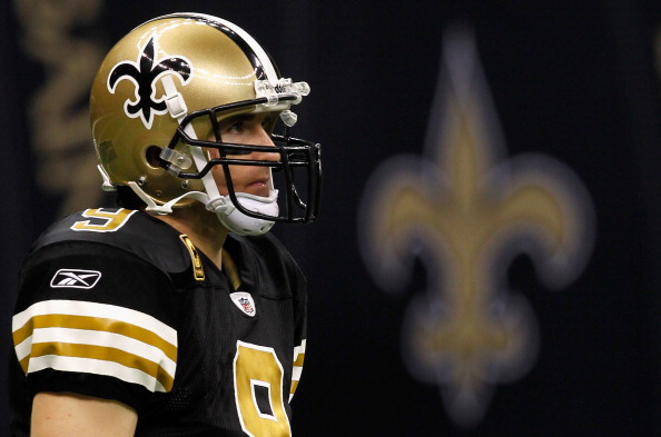 NEW ORLEANS, LA - NOVEMBER 06:  Drew Brees #9 of the New Orleans Saints watches on during their game against the Tampa Bay Buccaneers at Mercedes-Benz Superdome on November 6, 2011 in New Orleans, Louisiana.  (Photo by Streeter Lecka/Getty Images)