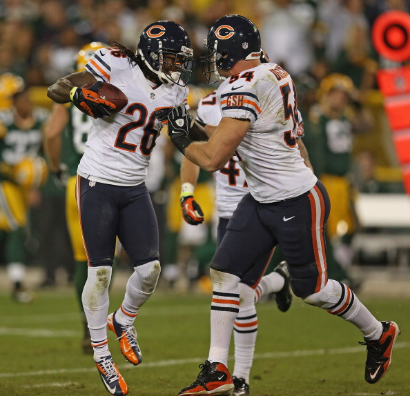GREEN BAY, WI - SEPTEMBER 13:  Tim Jennings #26 of the Chicago Bears celebrates an interception with Brian Urlacher #54 against the Green Bay Packers at Lambeau Field on September 13, 2012 in Green Bay, Wisconsin. The Packers defeated the Bears 23-10.  (Photo by Jonathan Daniel/Getty Images)