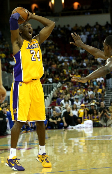 FRESNO, CA - OCTOBER 07:  Kobe Bryant #24 of the Los Angeles Lakers controls the ball against the Golden State Warriors at Save Mart Center At Fresno State on October 7, 2012 in Fresno, California.   NOTE TO USER: User expressly acknowledges and agrees that, by downloading and or using this photograph, User is consenting to the terms and conditions of the Getty Images License Agreement.  (Photo by Stephen Dunn/Getty Images)