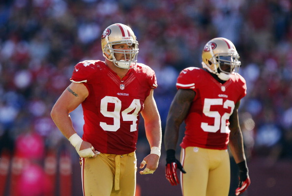 SAN FRANCISCO, CA - OCTOBER 14:  Defensive tackle Justin Smith #94 and linebacker Patrick Willis #52 of the San Francisco 49ers wait for a play against the New York Giants in the third quarter on October 14, 2012 at Candlestick Park in San Francisco, California.  The Giants won 26-3. (Photo by Brian Bahr/Getty Images)
