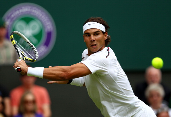 LONDON, ENGLAND - JUNE 26:  Rafael Nadal of Spain lines up a shot during his Gentlemen's Singles first round match against Thomaz Bellucci of Brazil on day two of the Wimbledon Lawn Tennis Championships at the All England Lawn Tennis and Croquet Club on June 26, 2012 in London, England.  (Photo by Clive Brunskill/Getty Images)