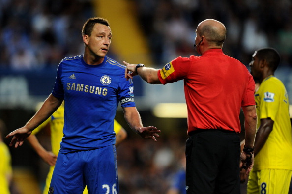 LONDON, ENGLAND - AUGUST 22: John Terry of Chelsea speaks to Referee Lee Mason during the Barclays Premier League match between Chelsea and Reading at Stamford Bridge on August 22, 2012 in London, England.  (Photo by Mike Hewitt/Getty Images)