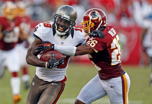 TAMPA, FL - SEPTEMBER 30:  Receiver Mike Williams #19 of the Tampa Bay Buccaneers is tackled by defender Josh Wilson #26 of the Washington Redskins during the game at Raymond James Stadium on September 30, 2012 in Tampa, Florida.  (Photo by J. Meric/Getty Images)
