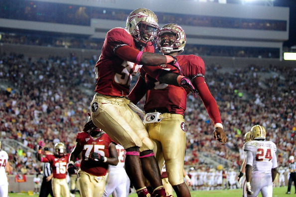 TALLAHASSEE, FL - OCTOBER 13:  James Wilder Jr. #32 and E.J. Emanuel #3 of the Florida State Seminoles celebrate a touchdown scored against the Boston College Eagles during a game at Doak Campbell Stadium on October 13, 2012 in Tallahassee, Florida.  (Photo by Stacy Revere/Getty Images)