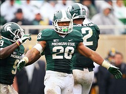 October 13, 2012; East Lansing, MI, USA; Michigan State Spartans linebacker Denicos Allen (28) reacts to play during the first half of  a game against the Iowa Hawkeyes at Spartan Stadium.    Mandatory Credit: Mike Carter-US PRESSWIRE