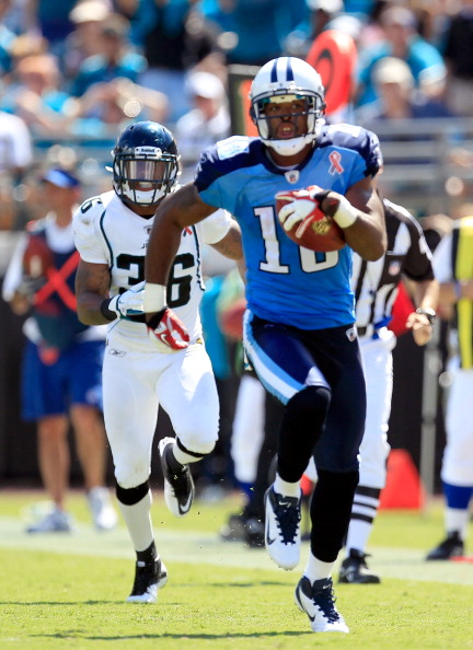JACKSONVILLE, FL - SEPTEMBER 11:  Kenny Britt #18 of the Tennessee Titans runs for yardage during the season opener game against the Jacksonville Jaguars at EverBank Field on September 11, 2011 in Jacksonville, Florida.  (Photo by Sam Greenwood/Getty Images)
