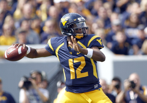 MORGANTOWN, WV - SEPTEMBER 29:  Geno Smith #12 of the West Virginia Mountaineers drops back to pass against the Baylor Bears during the game on September 29, 2012 at Mountaineer Field in Morgantown, West Virginia.  (Photo by Justin K. Aller/Getty Images)