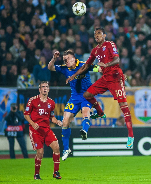 MINSK, BELARUS - OCTOBER 02:  Vitali Rodionov (C) of FC BATE Borisov jumps for the ball with Philipp Lahm (L) and Luiz Gustavo (R) of FC Bayern Muenchen during the UEFA Champions League group stage match between FC Bayern Muenchen and FC BATE Borisov at the Dinamo Stadium on October 2, 2012 in Minsk, Belarus. (Photo by Maksim Malinouski/EuroFootball/Getty Images)