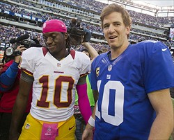 Oct 21, 2012; East Rutherford, NJ, USA; New York Giants quarterback Eli Manning (10) (right) meets Washington Redskins quarterback Robert Griffin III (10) (left)  after the New York Giants 27-23, come-from-behind win over the Washington Redskins at MetLife Stadium. Mandatory Credit: Andrew Mills/THE STAR-LEDGER via US PRESSWIRE