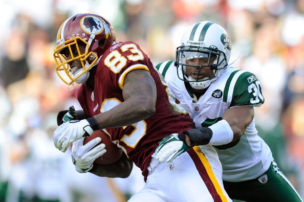 LANDOVER, MD - DECEMBER 04:  Fred Davis #83 of the Washington Redskins breaks a tackle by Donald Strickland #30 of the New York Jets at FedExField on December 4, 2011 in Landover, Maryland.  (Photo by Patrick McDermott/Getty Images)