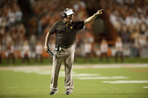 AUSTIN, TX - SEPTEMBER 1: Wyoming head coach Dave Christensen calls a play from the sideline against the Texas Longhorns on September 1, 2012 at Darrell K Royal-Texas Memorial Stadium in Austin, Texas.  (Photo by Cooper Neill/Getty Images)