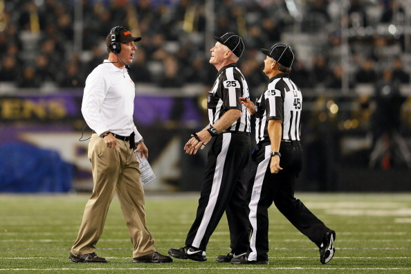 BALTIMORE, MD - SEPTEMBER 27:   Head coach Pat Shurmur of the Cleveland Browns argues with back judge Bob Waggoner #25 and line judge Jeff Seeman #45 during the NFL Game against the Baltimore Ravens at M&T Bank Stadium on September 27, 2012 in Baltimore, Maryland.  (Photo by Rob Carr/Getty Images)