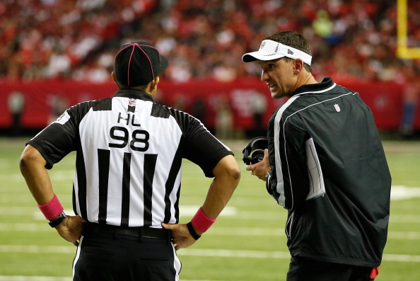 ATLANTA, GA - OCTOBER 14:  Head coach Dennis Allen of the Oakland Raiders converses with an official against the Atlanta Falcons at Georgia Dome on October 14, 2012 in Atlanta, Georgia.  (Photo by Kevin C. Cox/Getty Images)