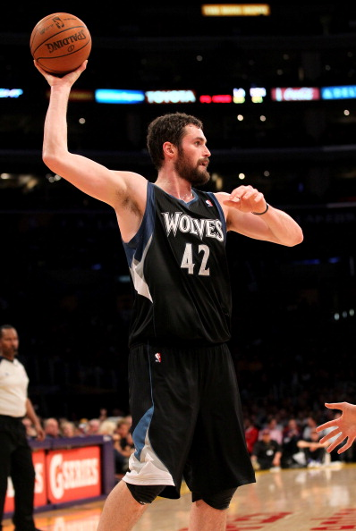 LOS ANGELES, CA - MARCH 16:  Kevin Love #42 of the Minnesota Timberwolves controls the ball against the Los Angeles Lakers at Staples Center on March 16, 2012 in Los Angeles, California.  The Lakers won 97-92.  NOTE TO USER: User expressly acknowledges and agrees that, by downloading and or using this photograph, User is consenting to the terms and conditions of the Getty Images License Agreement.  (Photo by Stephen Dunn/Getty Images)