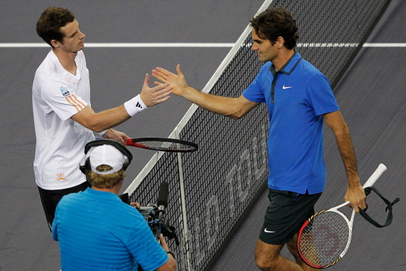SHANGHAI, CHINA - OCTOBER 13: Andy Murray of Britain (L) celebrates after defeating Roger Federer of Switzerland during the Men's Singles semi-finals of the Shanghai Rolex Masters at the Qi Zhong Tennis Center on October 13, 2012 in Shanghai, China.  (Photo by Lintao Zhang/Getty Images)
