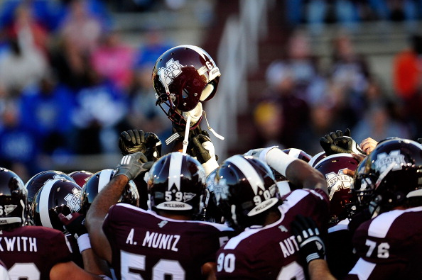 STARKVILLE, MS - OCTOBER 20:  Members of the Mississippi State Bulldogs gather in a huddle prior to a game against the Middle Tennessee State Blue Radiers on October 20, 2012 at Davis Wade Stadium in Starkville, Mississippi.  (Photo by Stacy Revere/Getty Images)