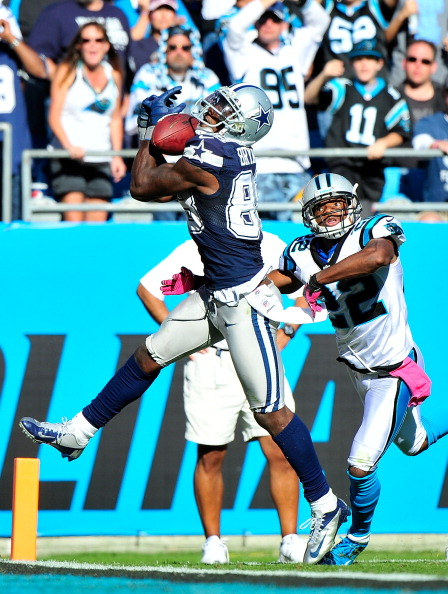 CHARLOTTE, NC - OCTOBER 21: Dez Bryant #88 of the Dallas Cowboys drops a pass in the end zone as Josh Thomas #22 of the Carolina Panthers defends during play at Bank of America Stadium on October 21, 2012 in Charlotte, North Carolina. The Cowboys won 19-14. (Photo by Grant Halverson/Getty Images)