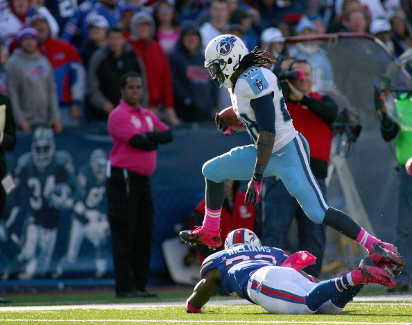 ORCHARD PARK, NY - OCTOBER 21: Chris Johnson #28 of the Tennessee Titans jumps over Aaron Williams #23 of the Buffalo Bills at Ralph Wilson Stadium on October 21, 2012 in Orchard Park, New York.Tennessee won 35-34. (Photo by Rick Stewart/Getty Images)