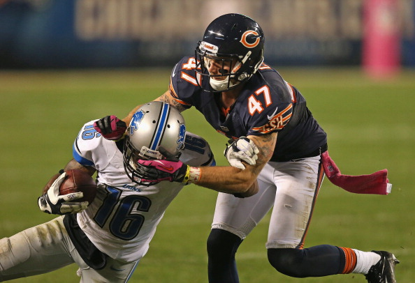 CHICAGO, IL - OCTOBER 22: Chris Conte #47 of the Chicago Bears brings down Titus Young #16 of the Detroit Lions at Soldier Field on October 22, 2012 in Chicago, Illinois. The Bears defeated the Lions 13-7. (Photo by Jonathan Daniel/Getty Images)