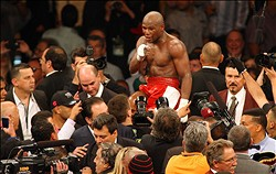 May 5, 2012; Las Vegas, NV, USA; Floyd Mayweather Jr. (center) is hoisted up after beating Miguel Cotto by unanimous decision at MGM Grand Garden Arena. Mandatory Credit: Jake Roth-US PRESSWIRE
