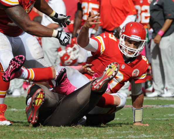 TAMPA, FL - OCTOBER 14:  Quarterback Brady Quinn #9 of the Kansas City Chiefs tumbles after releasing a pass against the Tampa Bay Buccaneers October 14, 2012 at Raymond James Stadium in Tampa, Florida.  The Bucs won 38 - 10. (Photo by Al Messerschmidt/Getty Images)