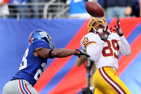 EAST RUTHERFORD, NJ - OCTOBER 21: Wide receiver Santana Moss #89 of the Washington Redskins makes a catch in the fourth quarter as cornerback Jayron Hosley #28 of the New York Giants defends during their game at MetLife Stadium on October 21, 2012 in East Rutherford, New Jersey.  (Photo by Alex Trautwig/Getty Images)