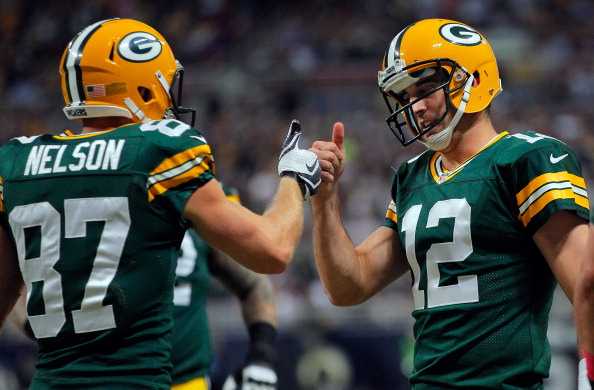 ST LOUIS, MO - OCTOBER 21:  Wide receiver Jordy Nelson #87 of the Green Bay Packers and quarterback Aaron Rodgers #12 of the Green Bay Packers celebrate their three yard touchdown reception against the St. Louis Rams in the first quarter at Edward Jones Dome on October 21, 2012 in St Louis, Missouri. The Packers defeated the Rams 30-20.   (Photo by Doug Pensinger/Getty Images)