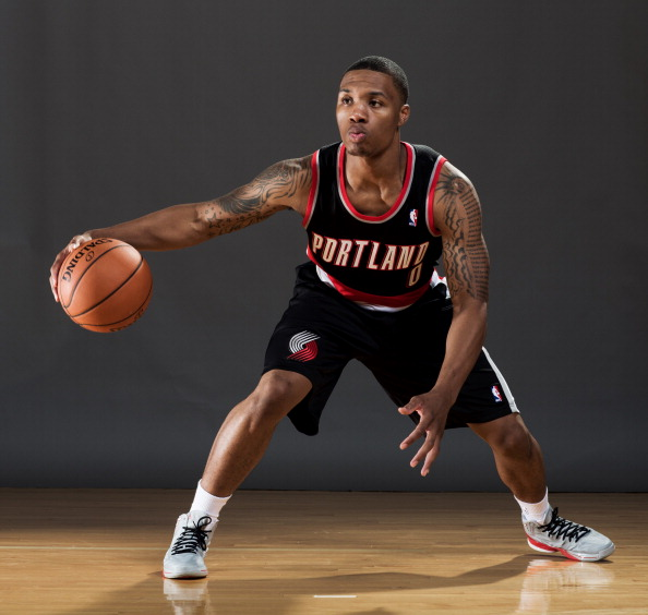 TARRYTOWN, NY - AUGUST 21:  Damian Lillard #0 of the Portland Trailblazers  poses for a portrait during the 2012 NBA Rookie Photo Shoot at the MSG Training Center on August 21, 2012 in Tarrytown, New York. NOTE TO USER: User expressly acknowledges and agrees that, by downloading and/or using this Photograph, user is consenting to the terms and conditions of the Getty Images License Agreement.  (Photo by Nick Laham/Getty Images)