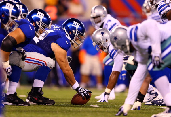 EAST RUTHERFORD, NJ - SEPTEMBER 05:  Center David Baas #64 of the New York Giants lines up under center against the Dallas Cowboys during the 2012 NFL season opener at MetLife Stadium on September 5, 2012 in East Rutherford, New Jersey.  (Photo by Al Bello/Getty Images)