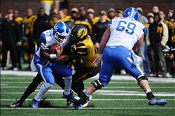 October 27, 2012; Columbia, MO, USA; Kentucky Wildcats quarterback Jalen Whitlow (13) is tackled by Missouri Tigers defensive back Randy Ponder (7) during the third quarter at Faurot Field. The Missouri Tigers defeated the Kentucky Wildcats 33-10. Mandatory Credit: Dak Dillon-US PRESSWIRE