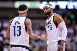 Oct 22, 2012; Dallas, TX, USA; Dallas Mavericks shooting guard Delonte West (13) and shooting guard Vince Carter (25) discuss strategy during the game against the New Orleans Hornets at the American Airlines Center. The Mavericks defeated the Hornets 87-74. Mandatory Credit: Jerome Miron-US PRESSWIRE