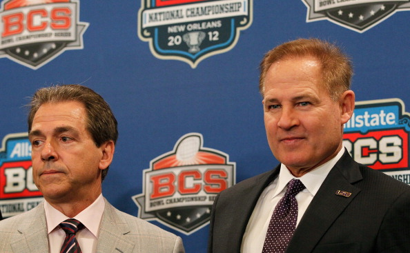 NEW ORLEANS, LA - JANUARY 08:  Head coach Nick Saban of the Alabama Crimson Tide and head coach Les Miles of the LSU Tigers pose with The Coaches' Trophy during the Allstate BCS Championship Press Conference on January 8, 2012 in New Orleans, Louisiana.  (Photo by Kevin C. Cox/Getty Images)