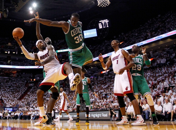 MIAMI, FL - JUNE 09:  LeBron James #6 of the Miami Heat goes up for a shot against Brandon Bass #30 of the Boston Celtics in the second half in Game Seven of the Eastern Conference Finals in the 2012 NBA Playoffs on June 9, 2012 at American Airlines Arena in Miami, Florida. NOTE TO USER: User expressly acknowledges and agrees that, by downloading and or using this photograph, User is consenting to the terms and conditions of the Getty Images License Agreement.  (Photo by Mike Ehrmann/Getty Images)