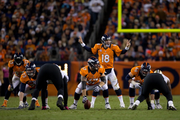 DENVER, CO - OCTOBER 28:  Quarterback Peyton Manning #18 of the Denver Broncos audibles at the line of scrimmage against the New Orleans Saints at Sports Authority Field Field at Mile High on October 28, 2012 in Denver, Colorado. (Photo by Justin Edmonds/Getty Images)