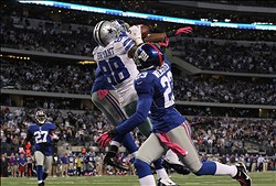 Oct 28, 2012; Arlington, TX, USA; Dallas Cowboys receiver Dez Bryant (88) makes a catch in the end zone in the fourth quarter against the New York Giants at Cowboys Stadium. Bryant was ruled out of bounds on the play. The Giants beat the Cowboys 29-24. Mandatory Credit: Matthew Emmons-US PRESSWIRE