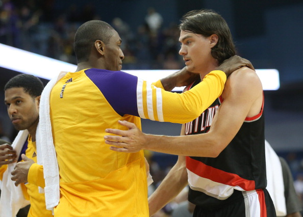 ONTARIO, CA - OCTOBER 10: Adam Morrison  #6 of the Portland Trail Blazers greets Metta World Peace #15 of the Los Angeles Lakers after the game at Citizens Business Bank Arena on October 10, 2012 in Ontario, California.  Portland won 93-75.  NOTE TO USER: User expressly acknowledges and agrees that, by downloading and or using this photograph, User is consenting to the terms and conditions of the Getty Images License Agreement.  (Photo by Stephen Dunn/Getty Images)